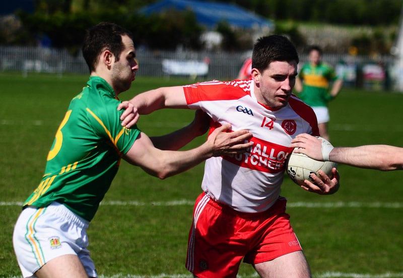 Brian Mallon finds his way curtailed by Gerard Barton Pearse Óg 3-16 Tír na nÓg 0-8 Armagh League Div1 Pearse Og Park, Armagh, 19 April 2015 Credit: LiamMcArdle.com