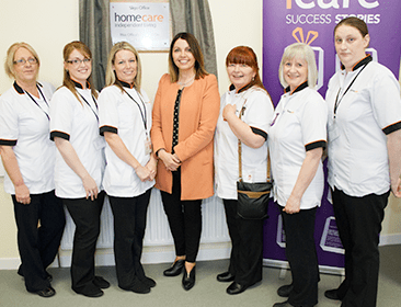 Mairead Mackle, centre, with members of the Homecare Independent Living care staff