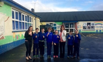 MLA Megan Fearon with Principal Lousie Campbell and pupils from Primary 7 in Killean PS