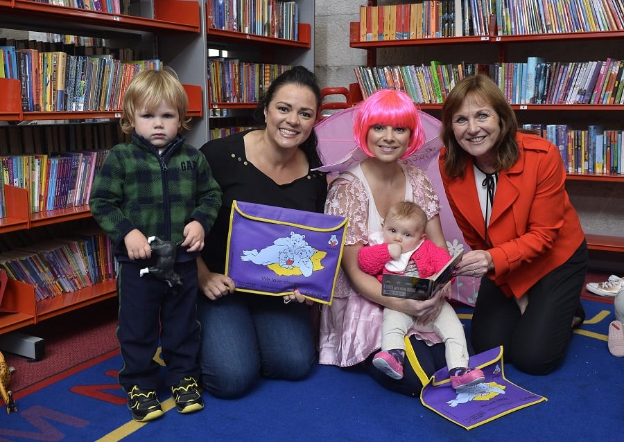 Pictured in photo at Armagh Library (L-R): Josh Oates (aged2) Natasha Sayee (SONI) Polly Pocket with Myia Wilson (6 months) & Liz Canning (Book Trust)