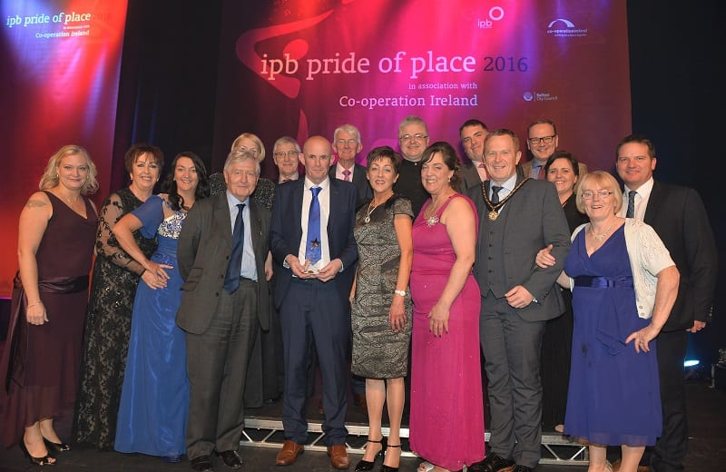 Pictured at the Pride of Place Awards ceremony are representatives from Keady Community, Cultural and Festival Group, Co Armagh along with Dr Christopher Moran, Chairman Co-operation Ireland and Tom Dowling, Chairman of the Pride of Place Committee