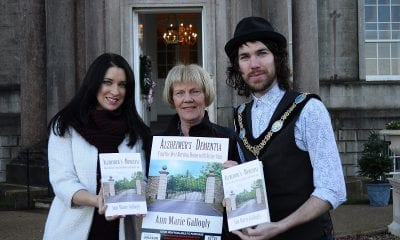 Lord Mayor of Armagh Garath Keating is joined by Cllr Sharon Haughey Grimley and local author Anne Gallogly to launch Anne's new book on dementia at The Palace Armagh