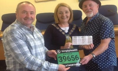 Larry Lambe and Pat McGinn with councillor Roisin Mulgrew