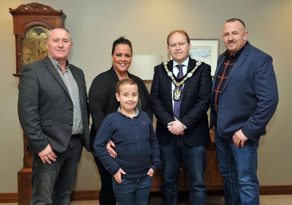 Lord Mayor of Armagh City, Banbridge and Craigavon, Councillor Gareth Wilson and Councillor Declan McAlinden welcome Donna and Stephen Green and son Ryan to Craigavon Civic Centre, to recognise their work for Asthma Awreness, after the death of their eldest son Tiernan last year.