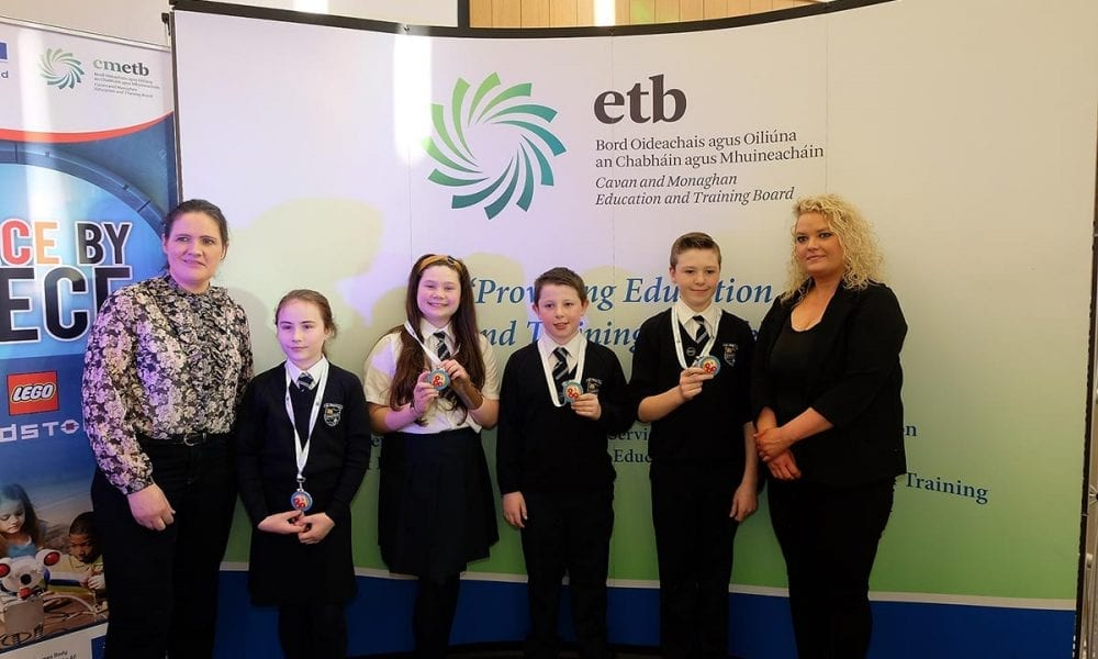 St Mary's Primary School Students receive their medals from Laura Brady Project Co ordinator CMETB