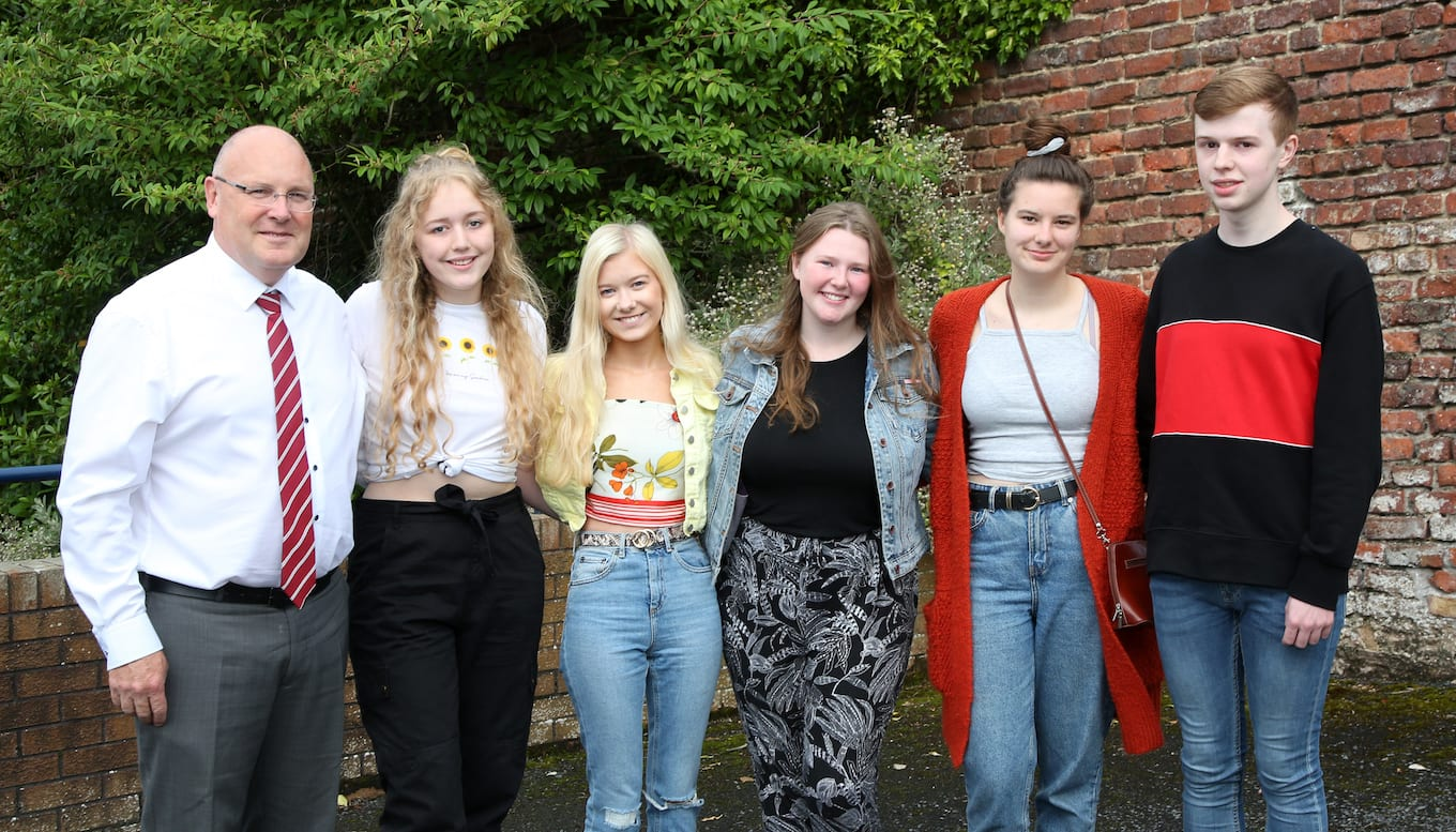 Vice Principal, Mr Hooks, congratulates Danielle Megaw, Hannah Monaghan, Katie Spence, Emma Herron and Adam Menary on their achievements.