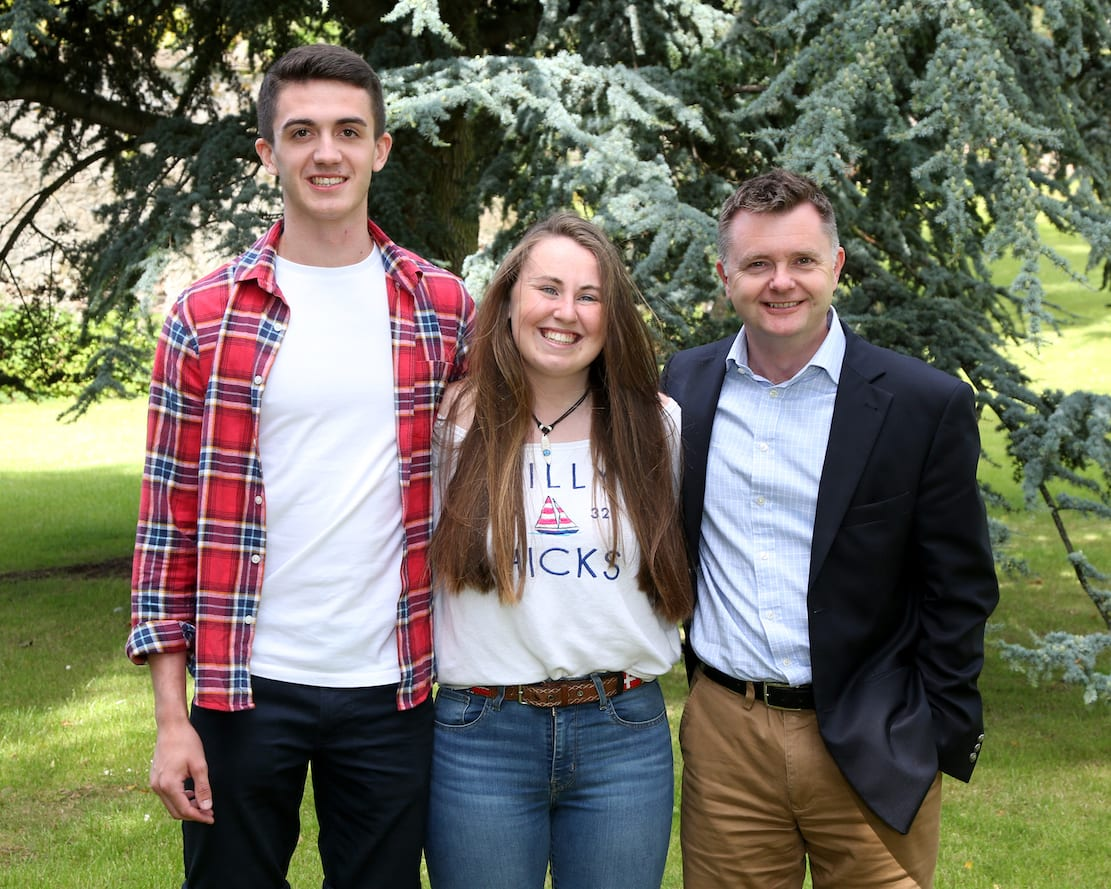 The Headmaster, Mr Montgomery, congratulates Head Boy Kyle Magwood and Head Girl Laura Hampton on their outstanding A Level results