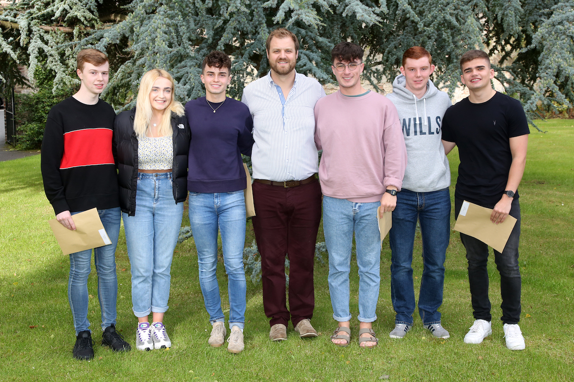 Head of Mathematics, Mr Cardwell, with some of the mathematicians: Adam Menary, Georgia Teague, William Pinkerton, Ben Hughes, Ryan Faulkner and James Brown