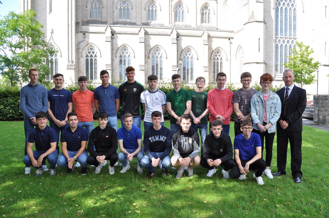 Delighted Year 14 students from St Patrick's Grammar School who achieved outstanding grades at A level! Pictured are the group of 19 students who each gained 2 or 3 A/A* grades. The successful students are pictured with Mr Dominic Clarke, School Principal
