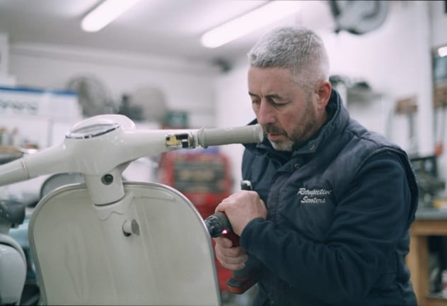 Niall mcCart working on a scooter