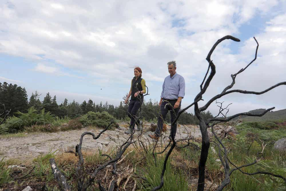 Minister Edwin Poots is pictured with Heather McLachlan, National Trust Director NI, at the site of the wildfire in the Mournes